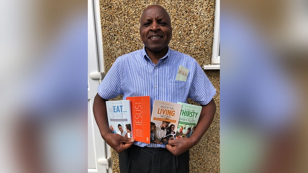 Pastor Michael Njagi Mbui from the South England Conference with some of the SPD resources. [Photo Courtesy of Adventist Record]