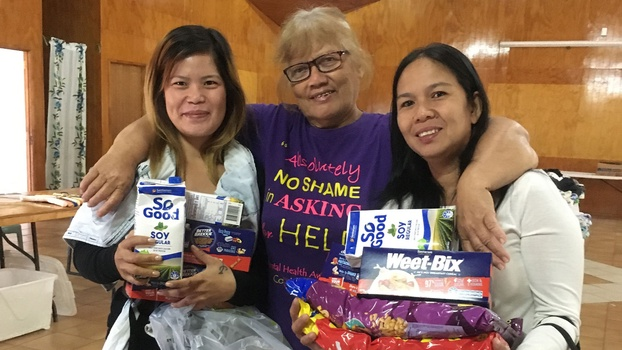 The church's head deaconess (center) with two Filipino women who received food and supplies. [Photo Courtesy of Adventist Record]