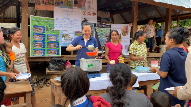 Chef Touktick demonstrates how to cook for children through the Positive Deviance/Hearth Program. She teaches mothers how to cook healthy food, especially for children. [Photo courtesy to ADRA Laos]