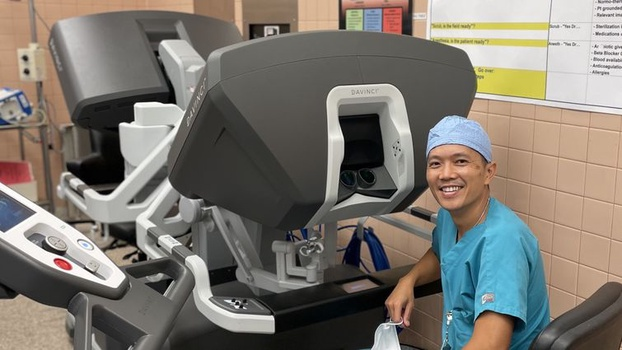 Dr. Le sits at the surgical robot's console, where he performs minimally invasive chest surgeries on patients [Photo Courtesy of Loma Linda University Health]