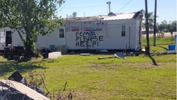 After Hurricane Ida tore through the area, signs such as the one pictured here blanketed Golden Meadow, Louisiana, where the United Houma Nation resides. [Photo provided by Adventist Community Service]