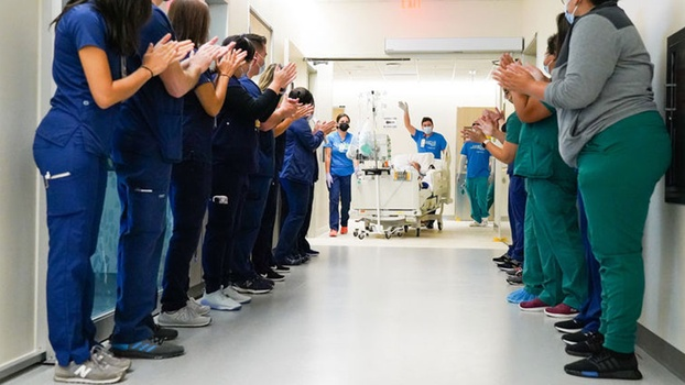 LLUH staff last month welcomed one of the first patients to be transferred to the new hospital during move-in day to the new facility. [photo by Chet Williams]