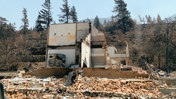 One of the many burnt-out houses after the Lytton Creek Wildfire scorched 90 percent of the Village of Lytton in British Columbia, Canada. [Photo by ADRA Canada]