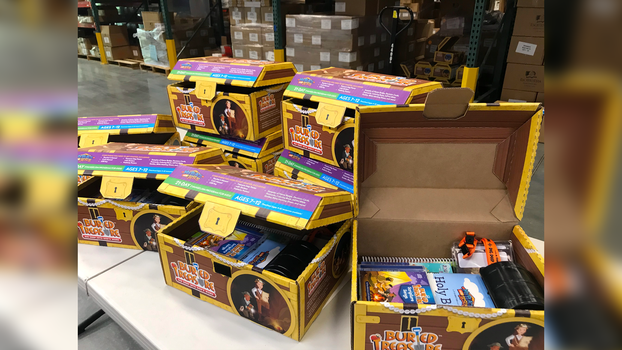 The Buried Treasure evangelism resource for children is prepped for shipping from It Is Written. [Photo Courtesy of It Is Written/North American Division]