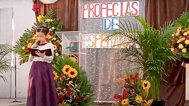 Nine-year-old Wendy Escalante delivers a message at an Adventist Church in Baja California, Mexico. The youngster began preaching from the age of three and recently gave Bible studies to a group of believers, which resulted in two baptisms. Her efforts, along with that of hundreds of laypersons in Baja California, have resulted in more than 500 baptisms as part of local and nationwide evangelistic efforts held during this second quarter of the year. [Photo: Screenshot]