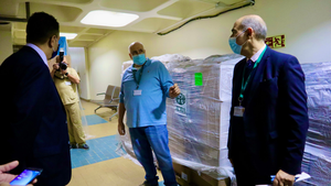 Hospital executives get a run-down of the recent shipment of deliverables that includes PPEs, gloves, face shields, surgical devices, and essential life-saving equipment.  [ADRA Lebanon]
