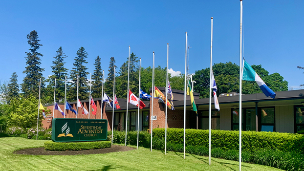 The Seventh-day Adventist Church in Canada flies flags at half staff at their headquarters in Ontario after 215 unmarked children's graves are found in Kamloops, British Columbia, Canada, at the former Kamloops Residential School site, in late May 2021.