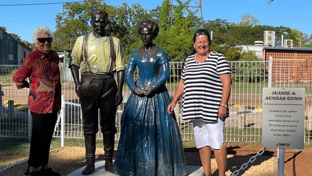 Florence Peters (left) and Roper Gulf mayor Judy MacFarlane with the statues of Jeannie and Aeneas Gunn. [Photo Courtesy of Adventist Record]