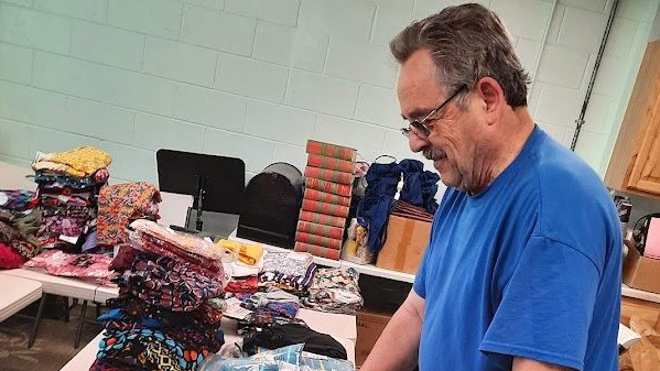 Gary Hartman of Milton Church volunteered to pack clothing items at the LightHouse Thrift Store in Columbus, Wisconsin